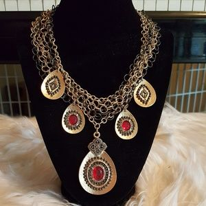 MULTI-CHAIN FEATURING DISKS W/ RED STONES